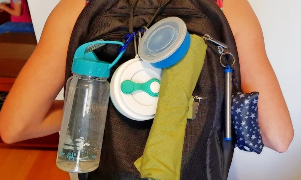 Plastic-free travel eco friendly gadgets attached to backpack